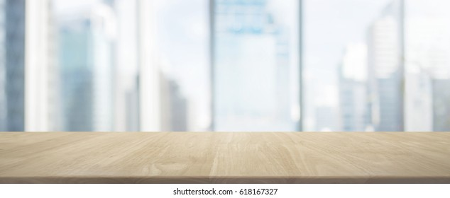 Wood table top and blur glass window wall building banner background - can used for display or montage your products.