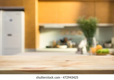 Wood table top with blur kitchen room interior in morning background .For montage product display or design key visual layout.