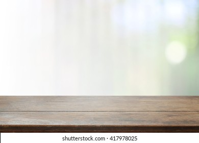 Wood table top and blurred bokeh background with vintage filter - can used for display or montage your products.