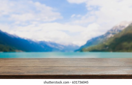 Wood table top and blurred lake & mountain background - can used for display or montage your products.