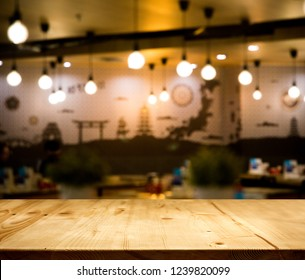 wood table top counter with night cafe club background in -use for display product on shelf with party time