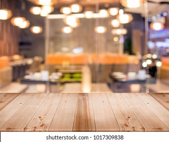 wood table top for display product with blur restaurant at background