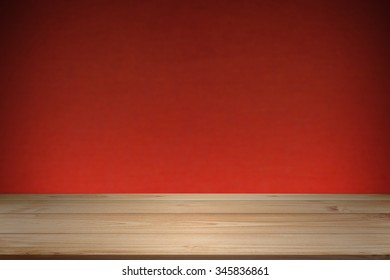 Wood table top isolated on red background - can be used for display or montage your products