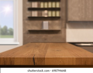 Wood table top as kitchen island on blur kitchen background - can be used for display or montage your products. Mock up for design.