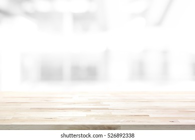 Wood table top on abstract blur white background - can be used for display or montage your products