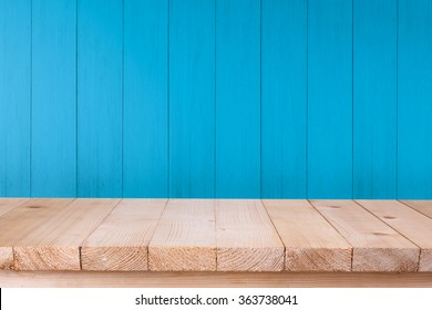 Wood table top on blue wood background