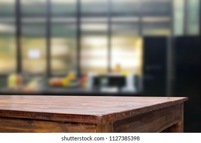Wood table top on blur kitchen or cafe room background .For montage product display design key visual layout.