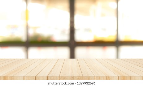 Wood table top on  with blur glass window wall background. 16:9