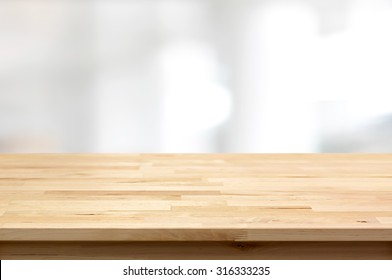 Wood table top on blur white gray abstract background - can be used for display or montage your products