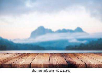 wood table top on blur background of river and mountain - can be used for display or montage your products