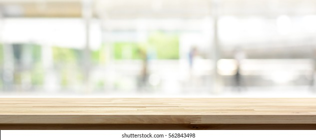 Wood table top on blur kitchen window background, panoramic banner - can be used for display or montage your products (or foods) - Shutterstock ID 562843498