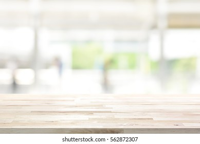 Wood table top on blur kitchen window background - can be used for display or montage your products (or foods)