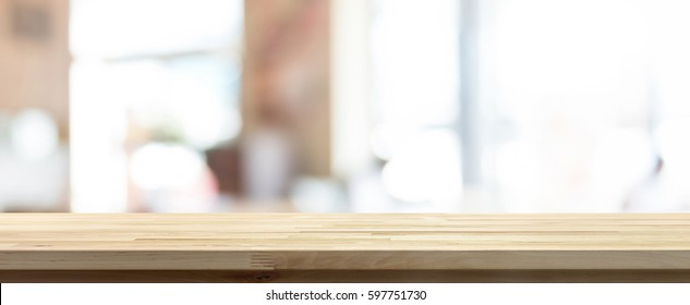 Wood table top on blur coffee shop (cafe) interior background, panoramic banner - can be used for display your products or foods