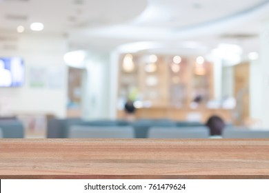 Wood table top on blur people in hospital background