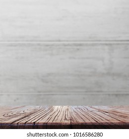 Wood table top on blurred light and dark wood background - can be used for display or montage your products.