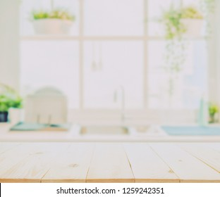 Wood table top on blurred kitchen background
