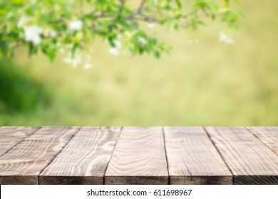 Wood table top on blurred green background,used for display products