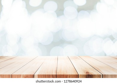 Wood table top on bokeh abstract background and used for montage or display products.