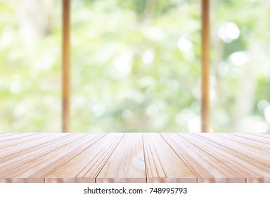 Wood table top on disfocus kitchen  background. can be used for