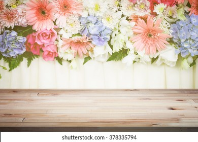 Wood table top on flower backdrop background