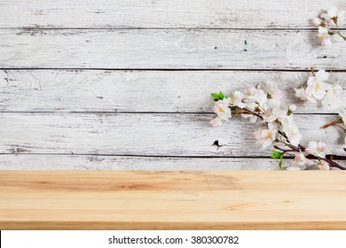 Wood table top on wood and flower background- can be used for display or montage your products