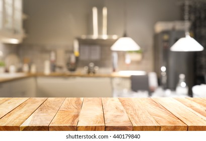 Wood table top on light abstract from kitchen room background .For montage product display or design key visual layout.