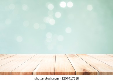 Wood table top on mint  bokeh abstract background and used for montage or display products.