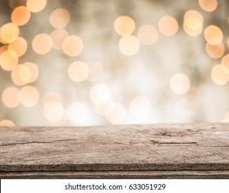 Wood table top on shiny bokeh gold background, vintage tone - can be used for display or montage your products
