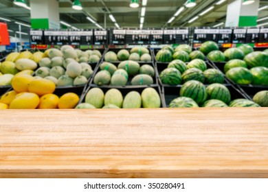 Wood table top and Supermarket fuzzy fruit background