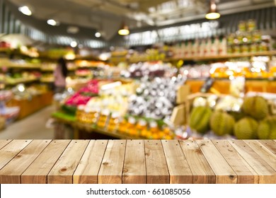 Wood table top and Supermarket tropical fruits background