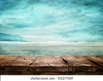 Wood table and tropical landscape in the background.. Spring or summer abstract nature background.