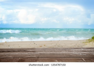 wood table with tropical summer ocean seascape background