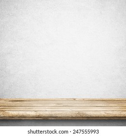 Wood table and white concrete wall background