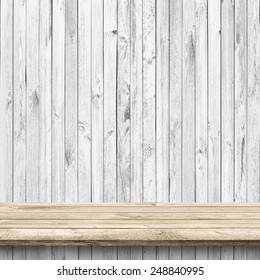 Wood table and white wooden wall background