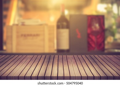 Wood table and wine Liquor bottle on shelf Blurred background can be used for display or montage your products.Vintage Color