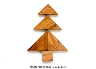 Wood tangram puzzle in christmas tree shape on white background