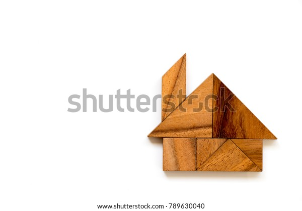 Wood tangram puzzle in home or house shape on white background
