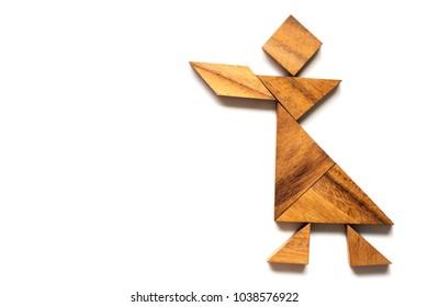 Wood tangram puzzle in singing man shape on white background