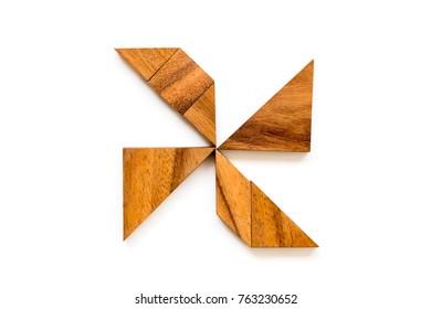 Wood tangram puzzle in turbine shape on white background