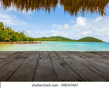 wood terrace on the sea beach with bamboo leaf as a roof of pavilion and sun light at Koh Mak island in Trat province, Thailand