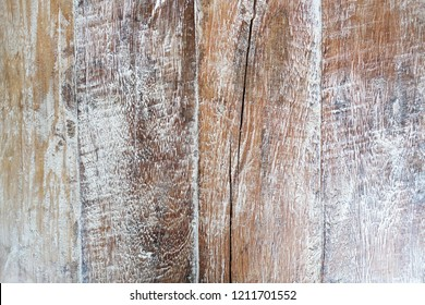 Wood texture background in light yellow beige color. It has some cracks.