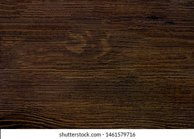 Wood texture background with natural patterns dark brown