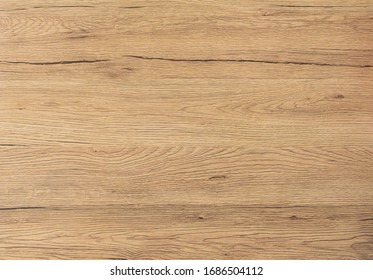 Wood texture background. Top view of vintage wooden table with cracks. Light brown surface of old knotted wood with natural color