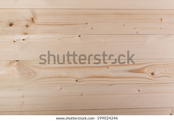 Wood texture background. Wooden board. Bright planks pattern. Decorative surface.