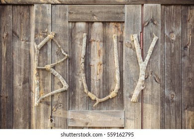 Wood Texture Background with wording 'BUY',with vintage toned style. Buy Concept.