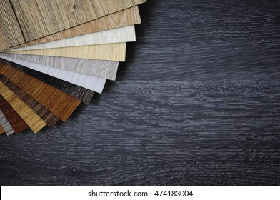 wood texture floor :oak tile, maple tile, chestnut tile, walnut tile, balsam tile,   Samples of laminate and vinyl floor tile on wooden Background