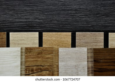 wood texture floor Samples of laminate and vinyl floor tile on wooden Background for new construction or renovate building or home renovate.