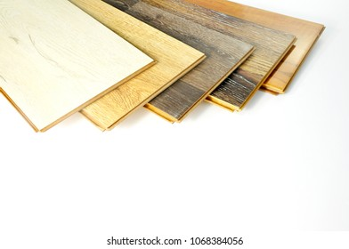 wood texture floor Samples of laminate and vinyl floor tile on white wooden Background for new construction or renovate building or home renovate.