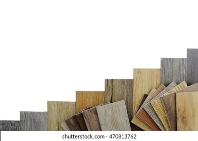 wood texture floor Samples of laminate and vinyl floor tile on wooden Background for new construction or renovate building