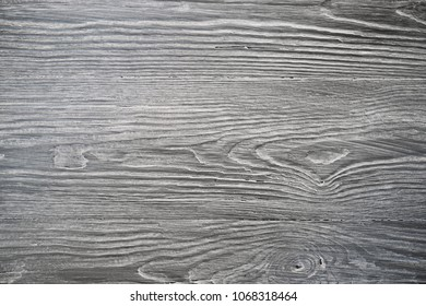Wood texture. Gray timber board with weathered crack lines. Natural background for shabby chic design. Grey wooden floor image. Aged tree surface close-up backdrop template.